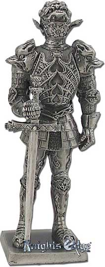 "This Italian medieval knight miniature figurine with sword is crafted from pewter. This knight figure adds the perfect decorating touch to your castle decor! Each exquisitely detailed knight stands with weapon. The Italian  knight with sword pewter figurine stands from 4-1/4"" tall."